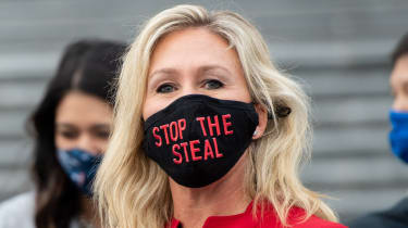Marjorie Taylor Greene wearing a 'stop the steal' face mask, a slogan associated with baseless allegations of election fraud