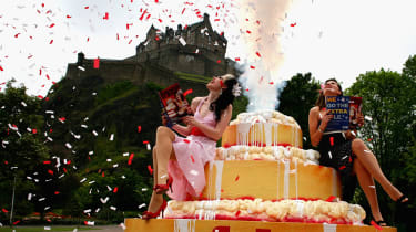 EDINBURGH, UNITED KINGDOM - JUNE 07:Missy Malone (L) and Naomi Howarth sit on a giant cake at the launch of the 2007 Edinburgh Fringe Festival programme June 7, 2007 in Edinburgh, Scotland. T