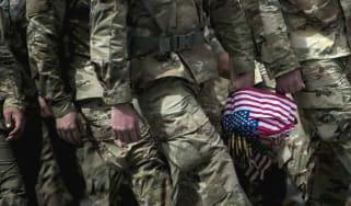wd-us_troops_flag_-_brendan_smialowskiafpgetty_images.jpg