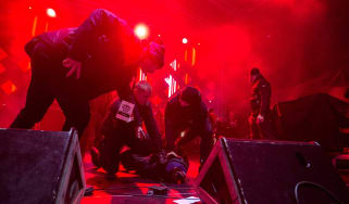 Security subdues a man who stabbed the mayor of Gdansk on stage in front of hundreds of people