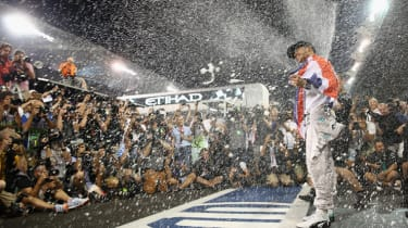 ABU DHABI, UNITED ARAB EMIRATES - NOVEMBER 23:Lewis Hamilton of Great Britain and Mercedes GP celebrates with his team after winning the World Championship after the Abu Dhabi Formula One Gra