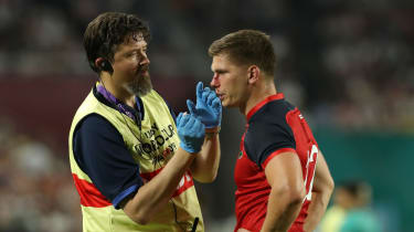 England's Owen Farrell receives treatment during the Rugby World Cup clash against the USA
