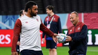 England head coach Eddie Jones receives the ball from flanker Billy Vunipola during the Captain's Run in Sapporo