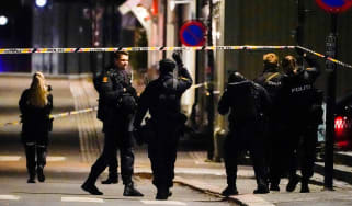 Police officers cordon off a crime scene in Kongsberg, Norway
