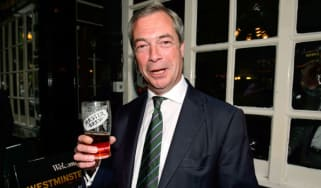 Nigel Farage poses with a pint