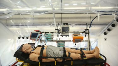 BERLIN, GERMANY - NOVEMBER 27:A mannequin lies in the isolation unit of a retrofitted Lufthansa plane equipped with medical facilities for Ebola cases during a media presentation at Tegel air