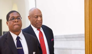 Bill Cosby leaves court after being found guilty on all counts of aggravated indecent assault