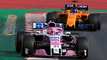 Esteban Ocon and Fernando Alonso drive during F1 pre-season testing in Barcelona in 2018