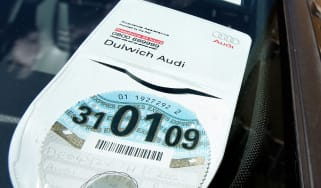 A 2008/ 2009 car tax disc is on display in a car windscreen on August 4, 2008 in London, England. Some MPs believe plans for new increased car tax rates on high fuel consumption vehicles shou