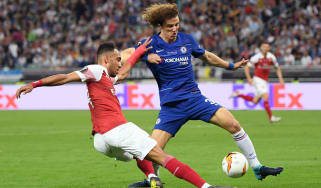 Chelsea defender David Luiz in action against Arsenal striker Pierre-Emerick Aubameyang