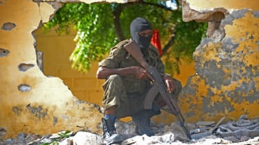 A Somali soldier responding to an Al Shabaab suicide attack in Mogadishu