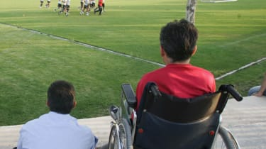 Disabled fan watching a football game