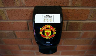 A hand sanitizer dispenser at Manchester United's Old Trafford stadium