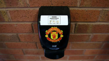 A hand sanitizer dispenser at Manchester United's Old Trafford stadium