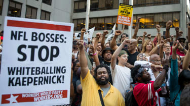 Activists rally in support of Colin Kaepernick outside NFL headquarters in New York