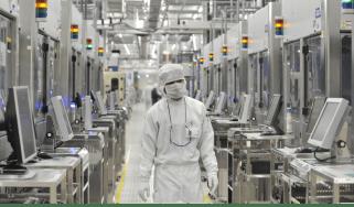 Employees of Japan's microprocessor maker Renesas Electronics in June 2021