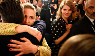 Opposition leader Mette Frederiksen (2L) of The Danish Social Democrats embraces supporters after the election results at Christiansborg Castle in Copenhagen early June 6, 2019, during the co