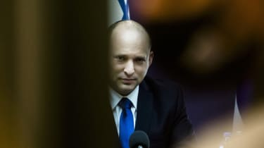 Natfali Bennett chairs a meeting of the new Israeli coalition government