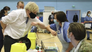 Boris Johnson visits a vaccination centre in Cwmbran, Wales.