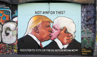 A mural on a derelict building in Bristol shows Donald Trump sharing a kiss with prominent Brexiter Boris Johnson