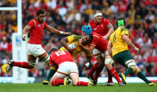 LONDON, ENGLAND - OCTOBER 10:Tevita Kuridrani of Australia is tackled by George North and Justin Tipuric of Wales during the 2015 Rugby World Cup Pool A match between Australia and Wales at T