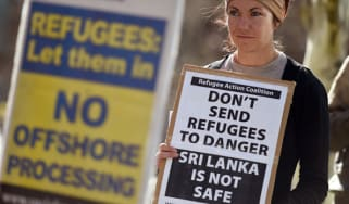 A woman protests Australian immigration policy