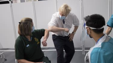 Boris Johnson visits a vaccination centre at Ashton Stadium, Bristol