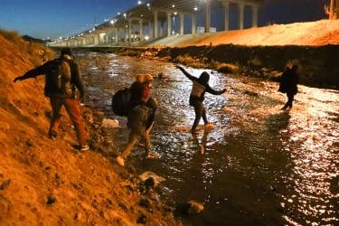 A group of migrants cross the Rio Bravo from Ciudad Juarez in Mexico into El Paso