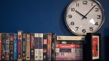 VHS tapes on a shelf.