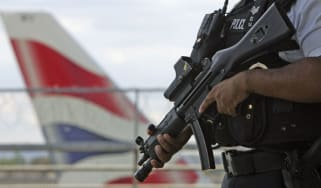 An armed officer patrols Heathrow Airport