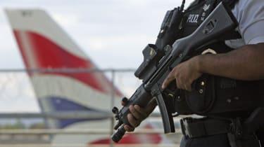 An armed officer patrols Heathrow Airport