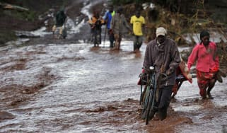 At least 47 people have been killed after a dam burst its banks in Kenya