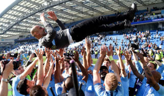 Manchester City players throw Pep Guardiola in the air after their Premier League title win