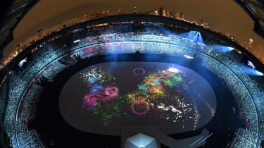 An overview shows the Olympic Stadium during the opening ceremony