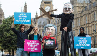 Protesters urge Theresa May to block Murdoch's takeover of Sky
