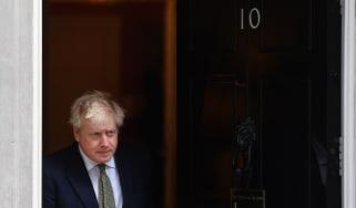 Boris Johnson emerges from 10 Downing Street