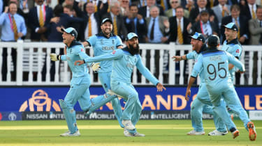 England wicketkeeper Jos Buttler celebrates with his team-mates after the win over New Zealand