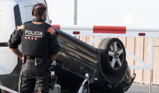Police guard the car allegedly used in the attack in Cambrils