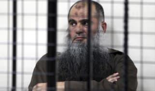 Abu Qatada behind the bars in Amman, Jordan