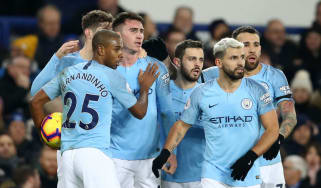 Manchester City players celebrate Aymeric Laporte's opener against Everton