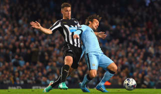Ryan Taylor of Newcastle United and  David Silva of Manchester City