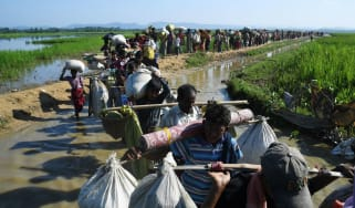 Rohingya refugees head towards the Balukhali refugee camp after crossing into Bangladesh
