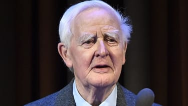 John le Carre addresses a conference in Sweden.