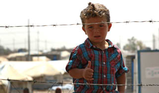 A displaced Iraqi boy at the Debaga camp, east of Makhmur in northern Iraq, in August