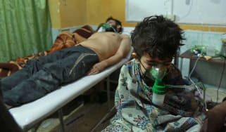 Syrian civilians get medical aid following suspected chlorine gas attack in Ghouta