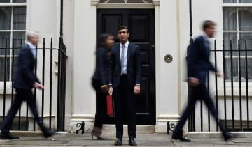 Chancellor of the Exchequer Rishi Sunak leaves 11 Downing Street for Parliament