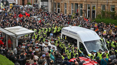 Protesters surround a UK Immigration Enforcement van in Glasgow