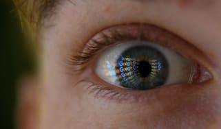 Google logo reflected in an eye