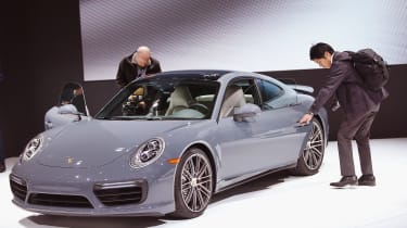 DETROIT, MI - JANUARY 11: Porsche introduces the new 911 Turbo S at the North American International Auto Show on January 11, 2016 in Detroit, Michigan. The show is open to the public from Ja