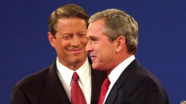 George W. Bush shakes hands with Al Gore before a debate in 2000.